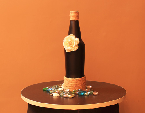 black-bottle-with-white-flower