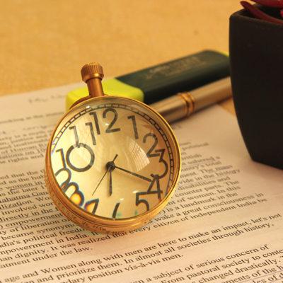 vintage-golden-timepiece-paper-weight