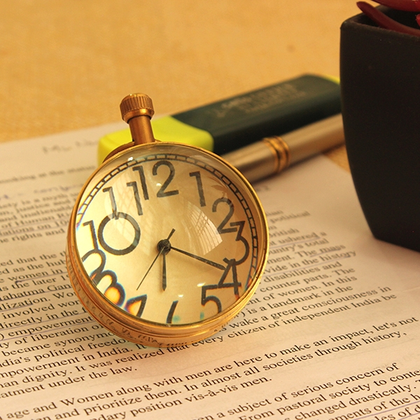 vintage-golden-timepiece-paper-weight